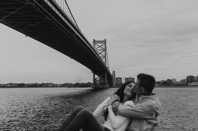 Cait + Marshall had their engagement photos taken by the Philadelphia Benjamin Franklin Bridge by Bridget Marie Photography